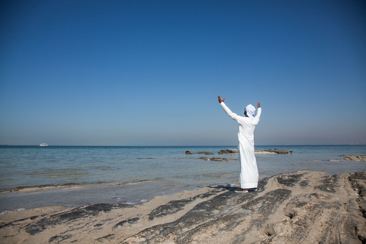 Adult Adults Only Ara Arms Raised Beach Beauty In Nature Clear Sky Day Emirati Hand Raised Horizon Over Water Human Arm Human Body Part Nature One Person One Woman Only Outdoors People Relaxation Sand Sea Sky Vacations Water Women