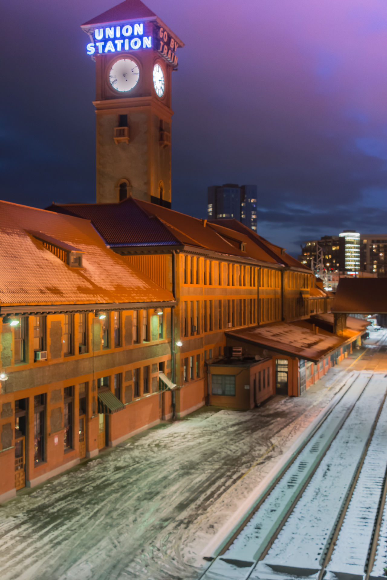 Architecture Building Exterior Built Structure City Cold Temperature Illuminated Night Night Photography No People Outdoors Rail Transportation Railroad Track Roof Sky Snow Train Station Travel Destinations Winter
