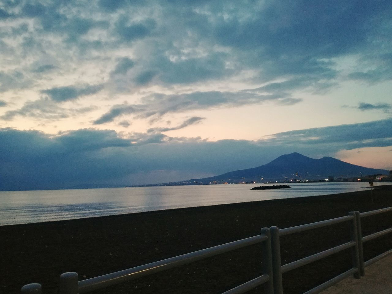 sea, water, sky, railing, scenics, cloud - sky, tranquil scene, horizon over water, mountain, tranquility, beauty in nature, nature, outdoors, beach, sunset, no people, day