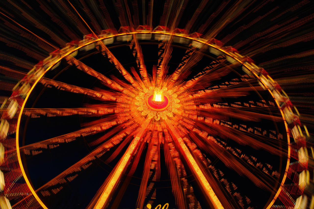 night, illuminated, low angle view, amusement park, no people, architecture, outdoors