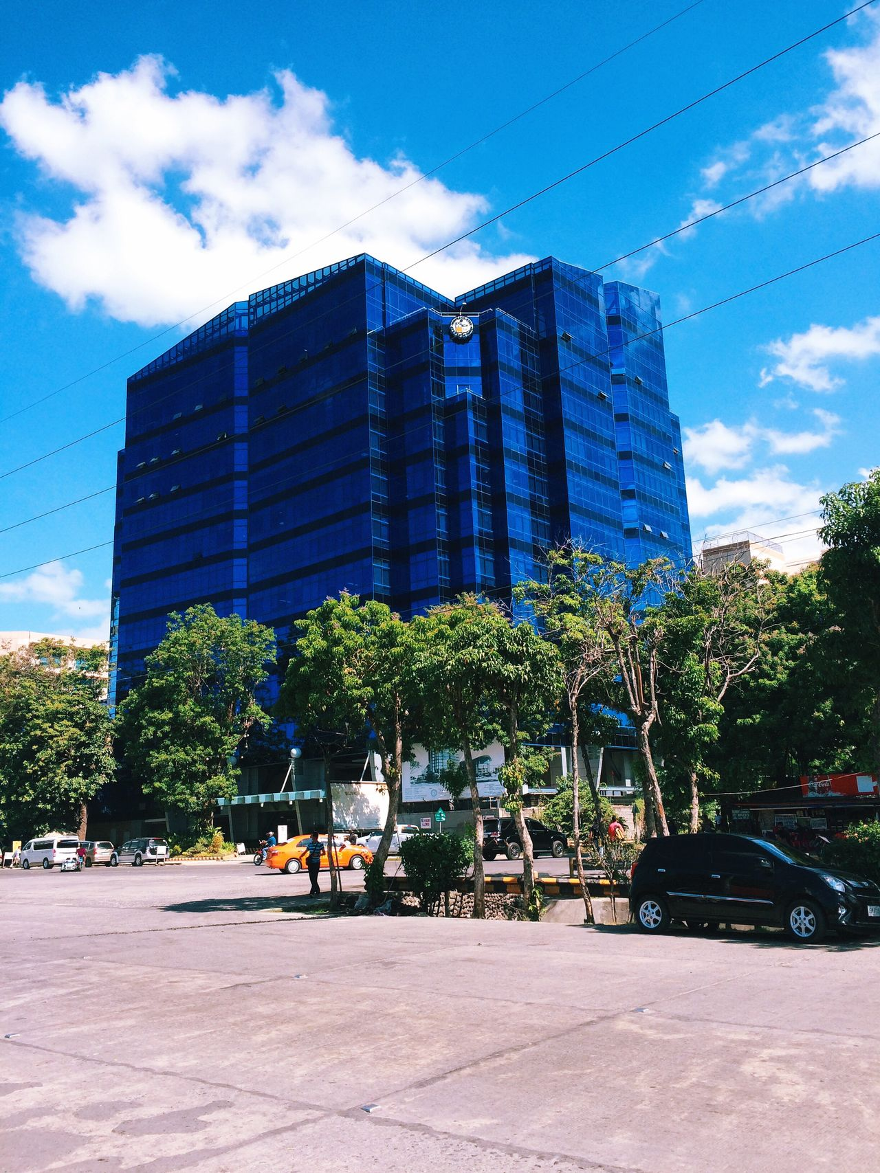 The Color Of School Blue Blue Sky Ateneo Architecture Built Structure Building Exterior Tree City Road Transportation Office Building Car Street Tall - High Ateneo De Davao Cloud - Sky Outdoors Cloud University TakeoverContrast