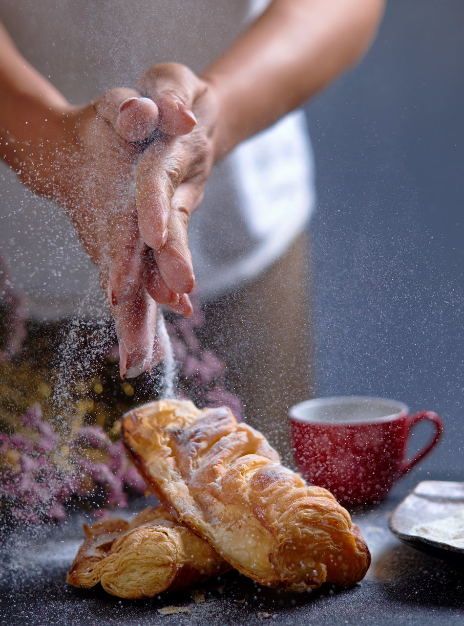 Adult Adults Only Baked Baked Pastry Item Bread Cooking At Home Day Food Food And Drink Freshness Holding Human Body Part Human Hand Icing Sugar Indoors  One Person People Sprinkle Sweet Food Sweet Pie