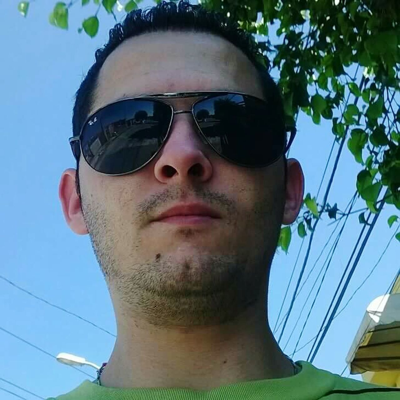 sunglasses, day, real people, portrait, looking at camera, outdoors, one person, lifestyles, young adult, tree, close-up, sky