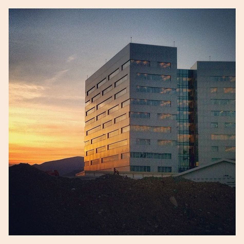 Sunset on concrete and glass Iphonephoto Genova Instaily Street building city