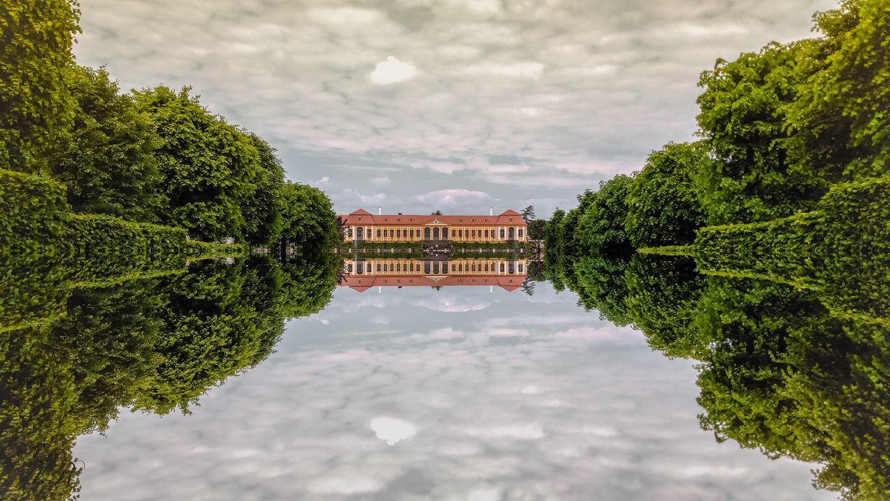 tree, green color, built structure, architecture, building exterior, nature, water, outdoors, no people, day, sky, growth, cloud - sky, plant, beauty in nature