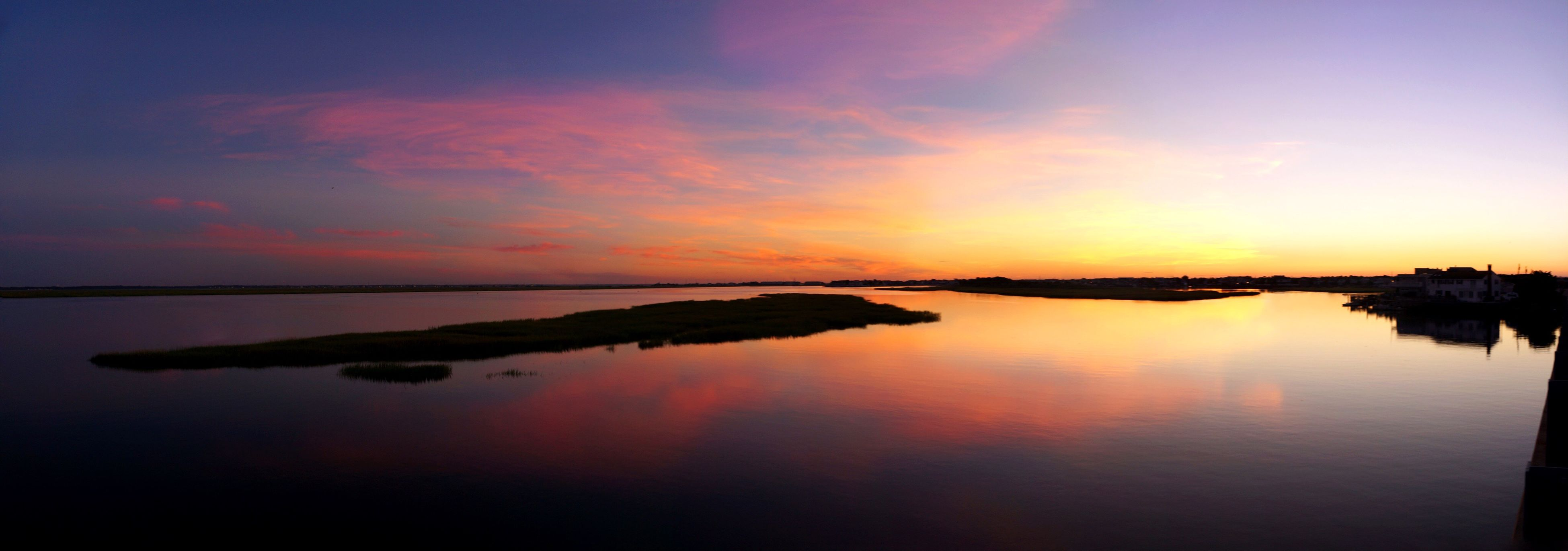 sunset, water, reflection, scenics, tranquil scene, tranquility, beauty in nature, orange color, idyllic, lake, waterfront, sky, nature, calm, standing water, travel destinations, cloud - sky, non-urban scene, dramatic sky, sea, majestic, tourism, romantic sky, atmosphere, atmospheric mood, vacations, no people, ocean