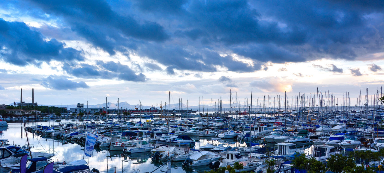 EyeEmNewHere Boats Bay Sunset Cold Sunset Blue Ships Mallorca Alcudia Motorboat Tranquility Peace Fishing Boats Jachthaven Boatharbour Parking Lot Parking Holiday No People Insurance Shiplife Off The Grid Rental Jacht Harbour