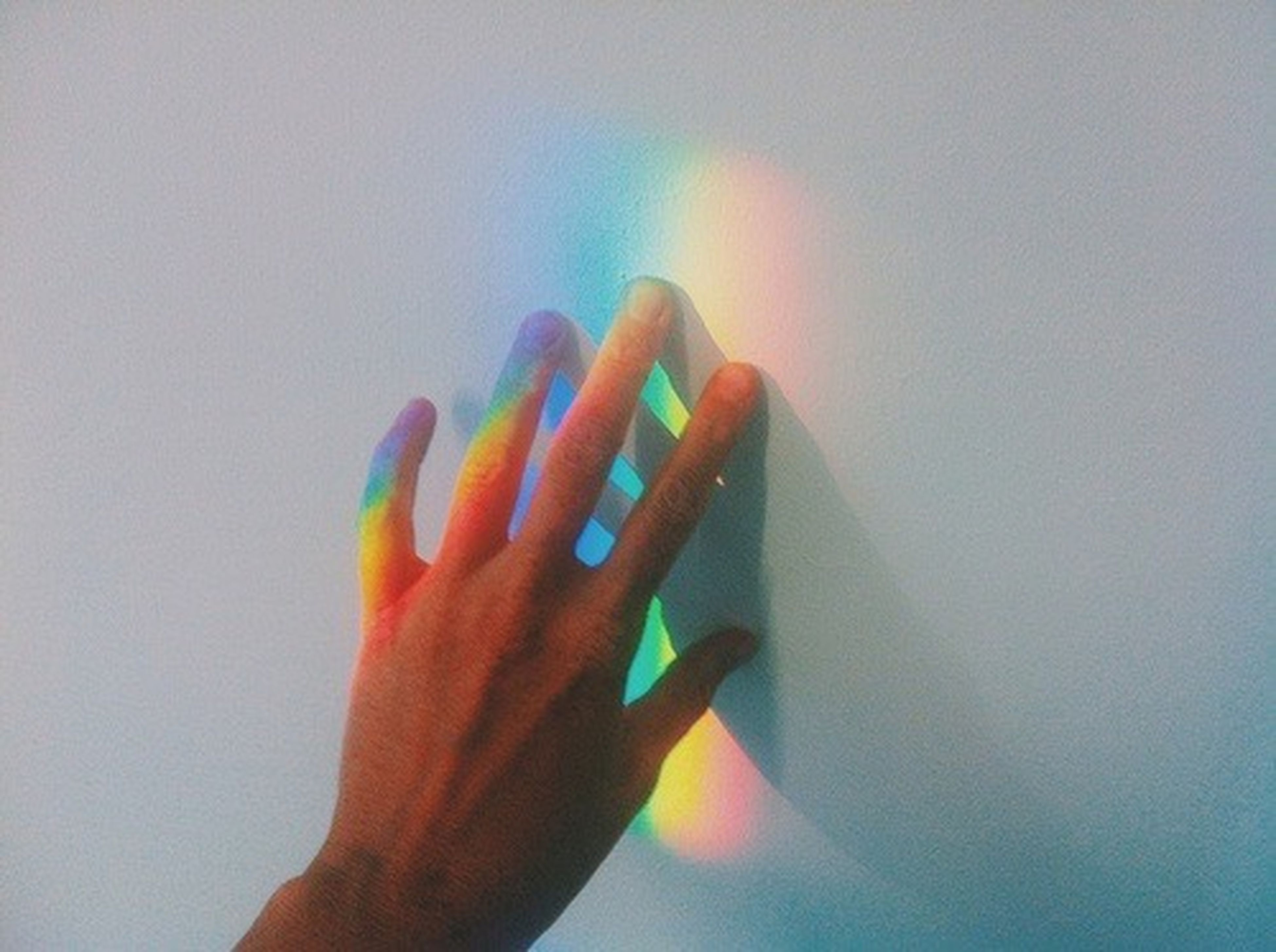 human hand, multi colored, human body part, human finger, one person, rainbow, close-up, indoors, spectrum, palm, nail polish, people, adult, adults only, sky, day