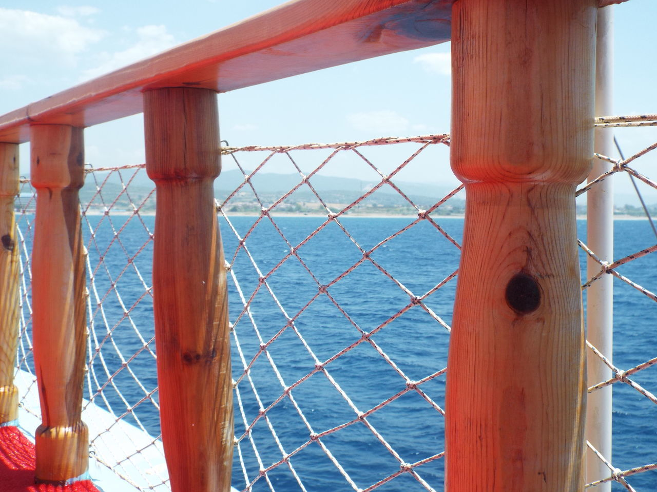 On A Boat Boat Trip Mediterranean Sea Sea Blue Water Tourist Attraction  Day Trip Tourism Travel Destinations Travel Photography Boat Mountains Coastline Rope Railing Wooden Railing Safety Blue Sky Blue Wave On The Way