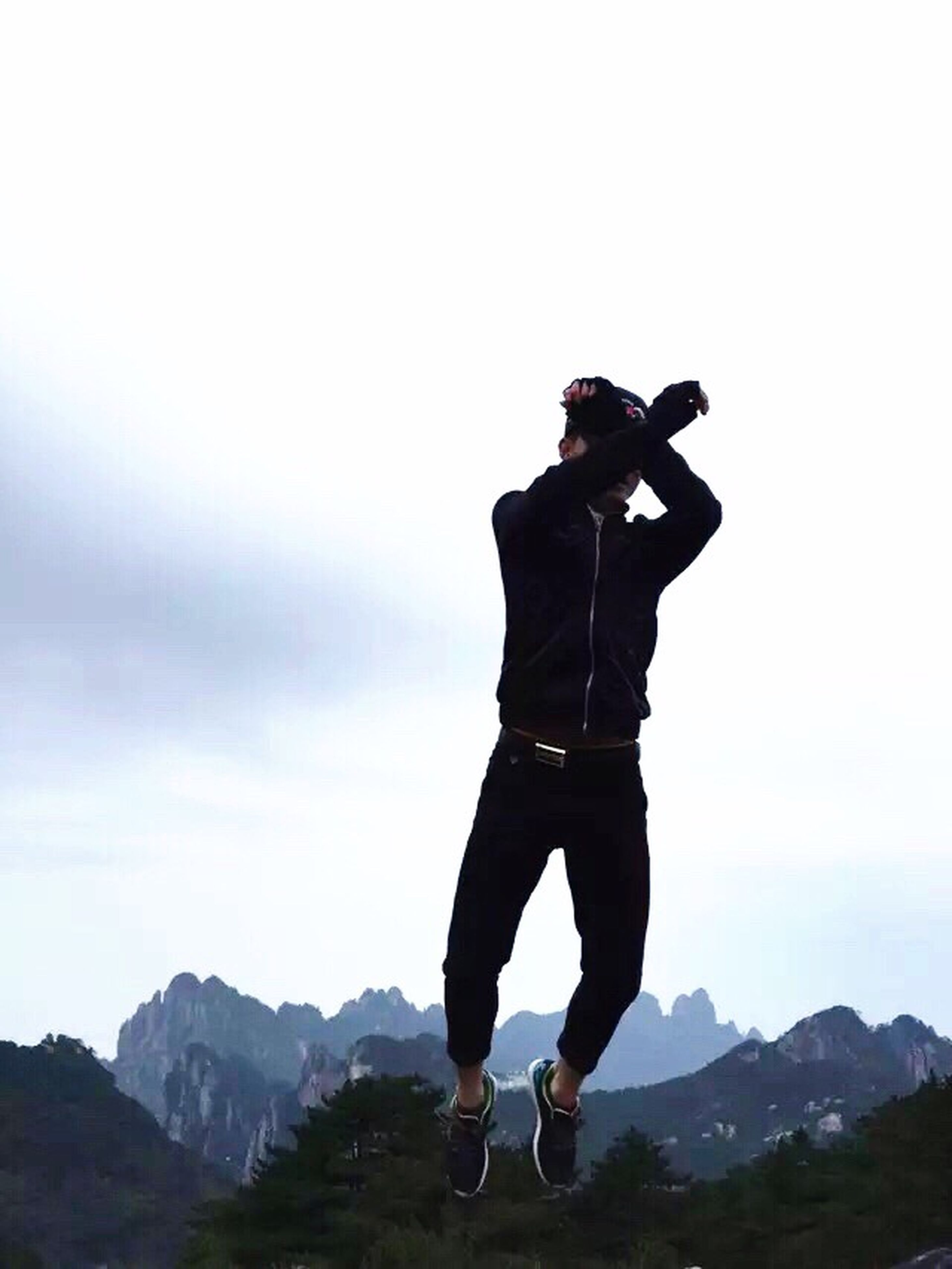 lifestyles, full length, leisure activity, mountain, standing, sky, men, casual clothing, rear view, mountain range, photography themes, arms outstretched, three quarter length, young men, photographing, landscape, young adult, holding