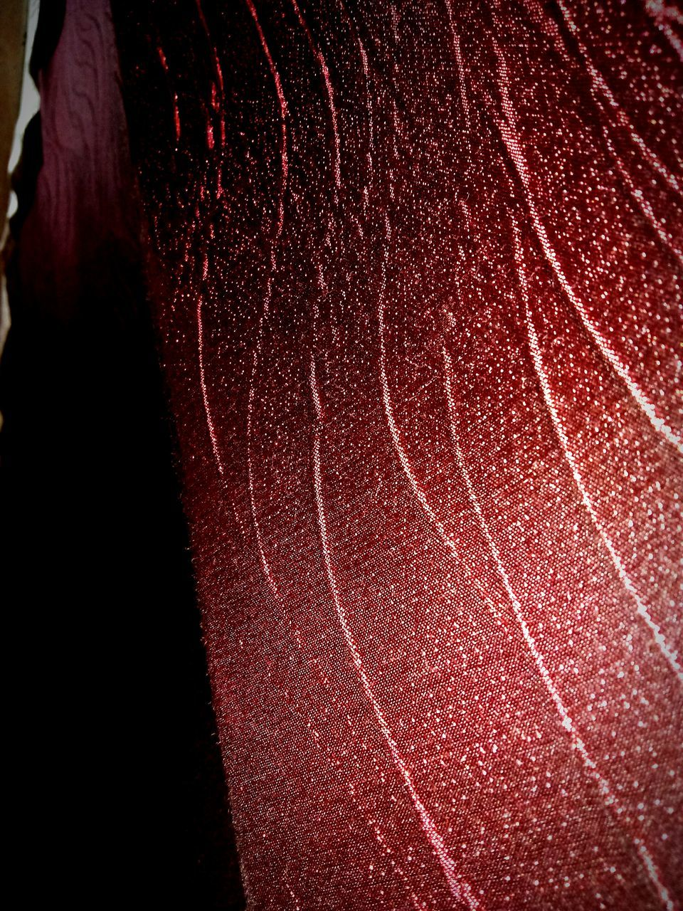 red, textured, close-up, no people, night, black background, outdoors