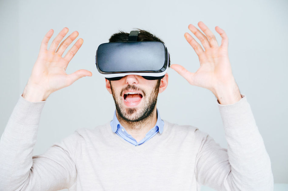 3-d Glasses Adult Adults Only Cyberspace Enjoyment Excitement Futuristic Gesturing Human Body Part Human Hand Innovation Men One Man Only One Person Only Men People Scared Shouting Surprised Technology Virtual Reality Virtual Reality Simulator Vr Wearable Computer Wireless Technology