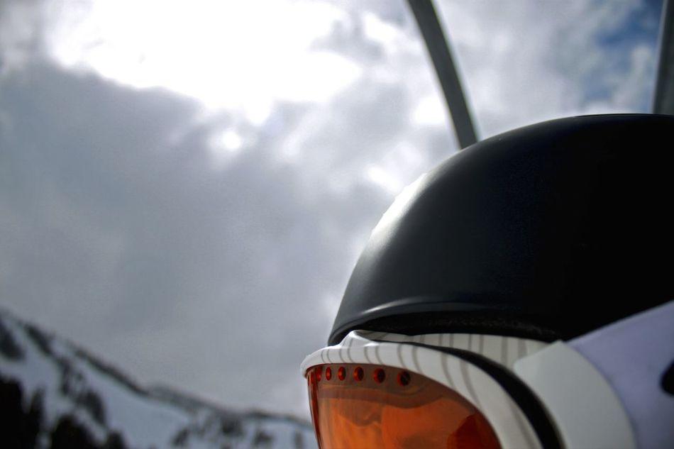 Cloud - Sky Outdoors Day Sky Headwear Winter Sports Mountain Sports Downhill Skiing Downhill/ Freeride Skiing Ski Dramatic Sky Ski Lift Winter Sport Ski Helmets Ski Goggles Goggles Goggle Snowboard Snowboarding Snowboard Goggles Snowboard Helmet Leisure Activity Adventure Sports Snow Sports