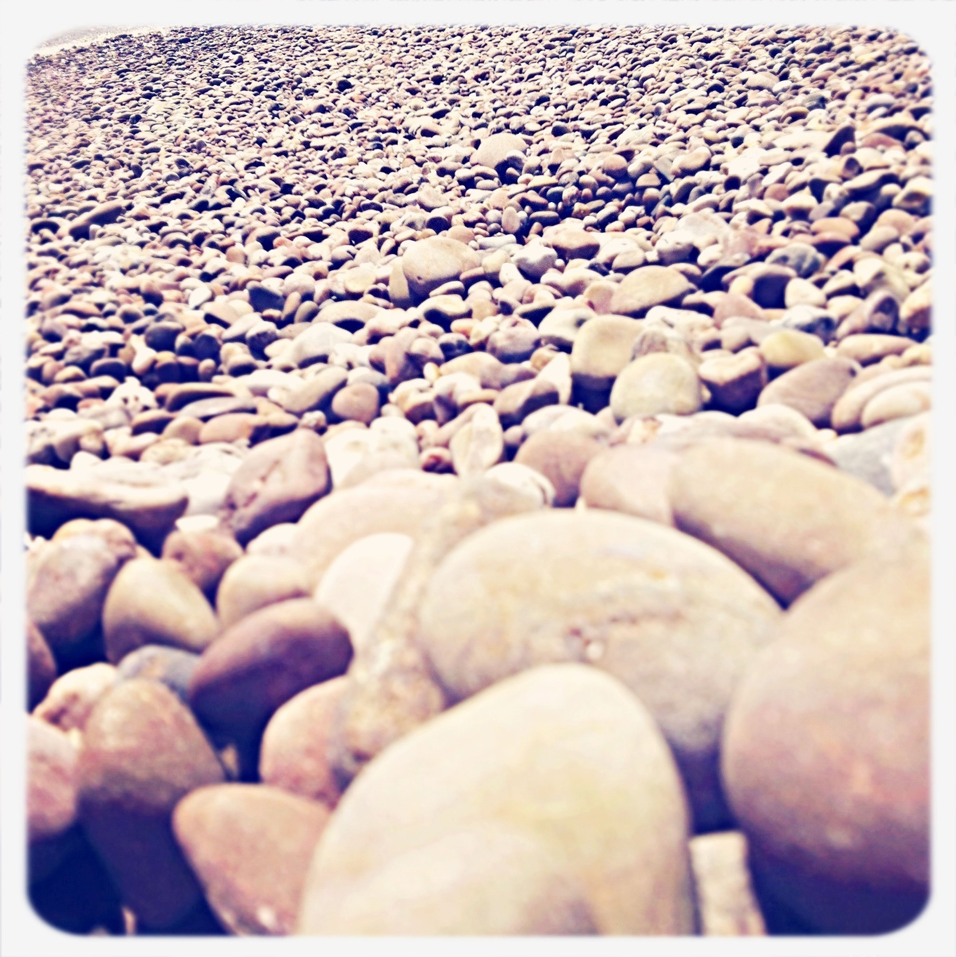 transfer print, auto post production filter, abundance, large group of objects, pebble, high angle view, close-up, day, stone - object, indoors, no people, nature, beach, stack, selective focus, backgrounds, full frame, rock - object, sunlight