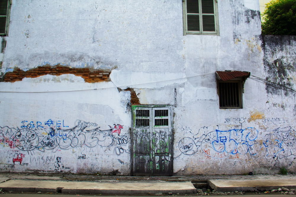old building wall Ancient Brick Wall Deserted House INDONESIA Medan Paint Retro Textured  Tourist Wall Wood Abstract Architecture Backgrounds Brick Building Exterior Built Structure City Crack Day Deserted Dilapidated Door Graffiti House No People Old Buildings Outdoors Window