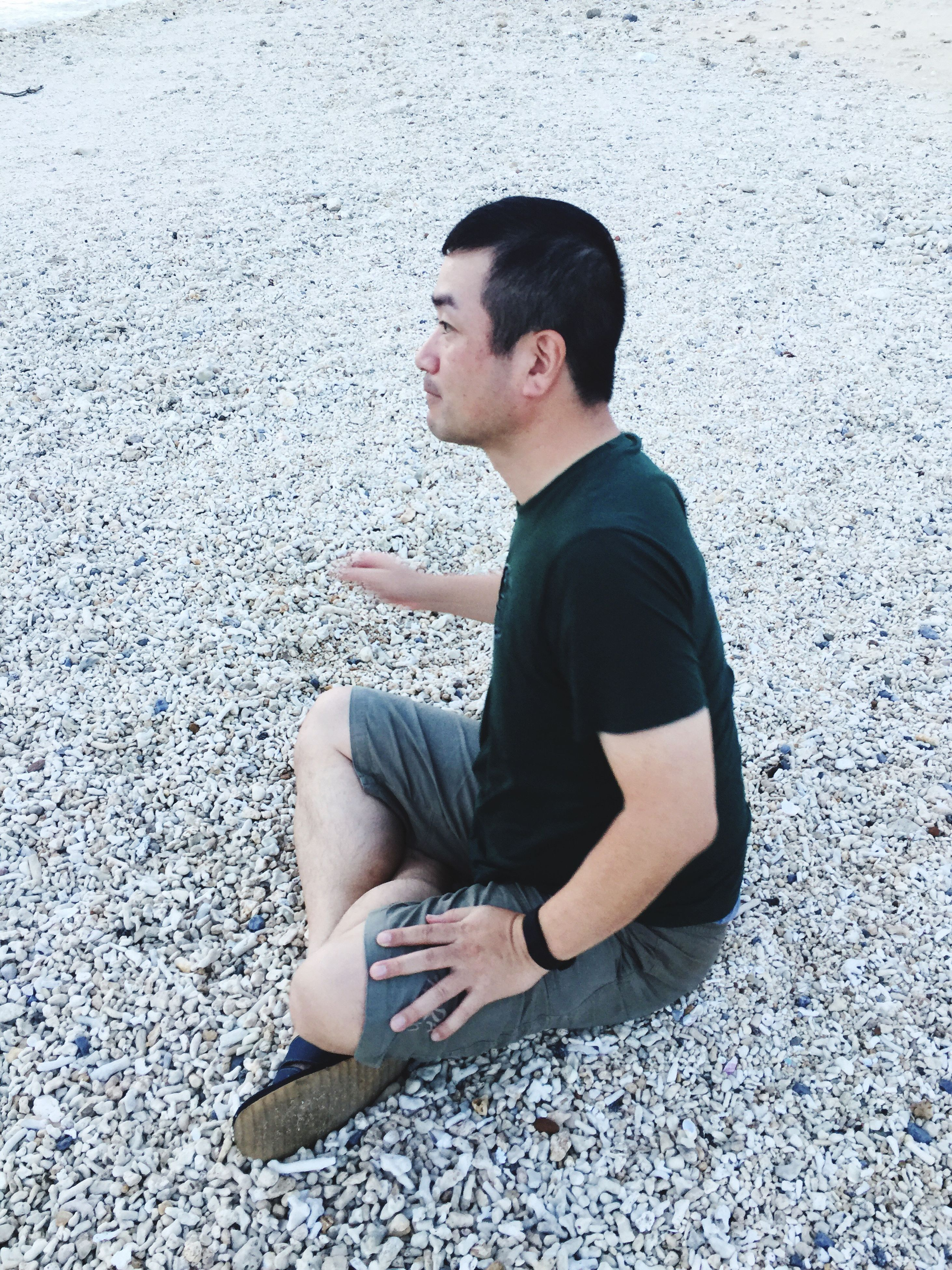 young adult, sitting, full length, casual clothing, person, outdoors, contemplation, day, looking, handsome