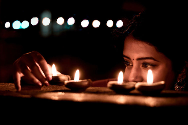 A picture of a girl lighting lamps during the festival of Diwali in India. Diwali India Festival Indianfestival Woman Girl Eyes Lights Night Portrait EyeEm Best Shots Candle Lifestyle Culture Indianculture Illuminated Diwali In India Portrait Of A Woman