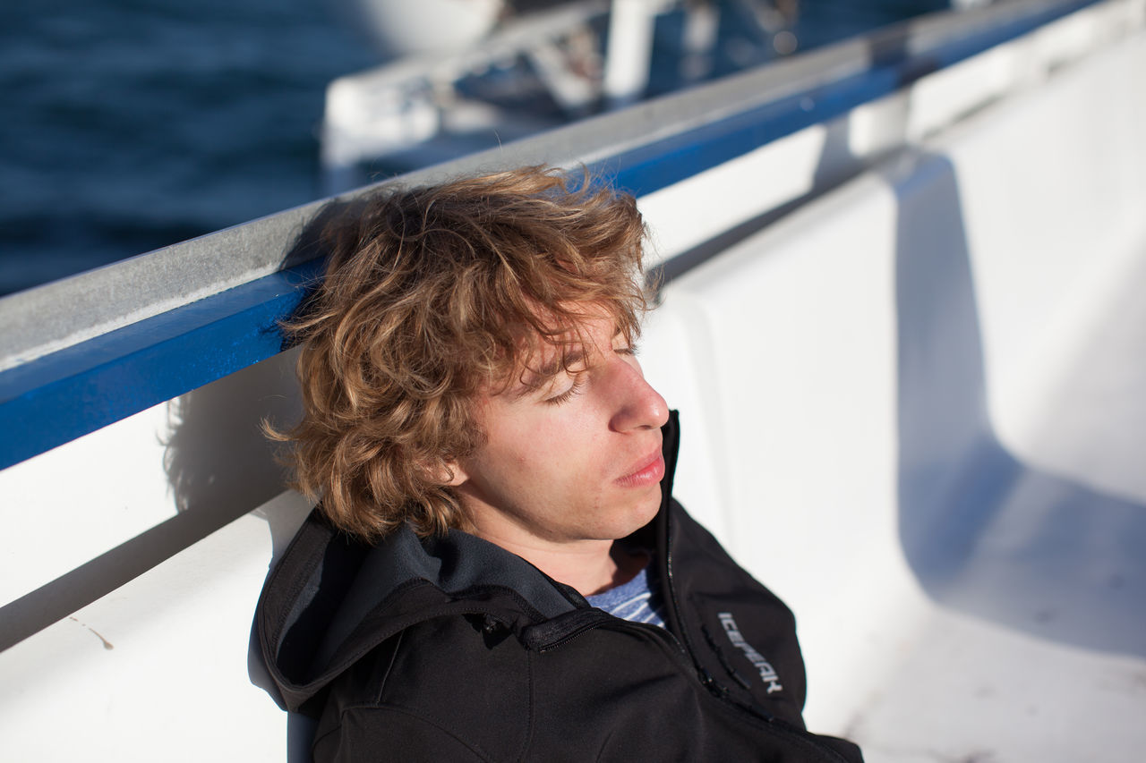 transportation, real people, one person, nautical vessel, boys, mode of transport, childhood, sea, outdoors, day, water