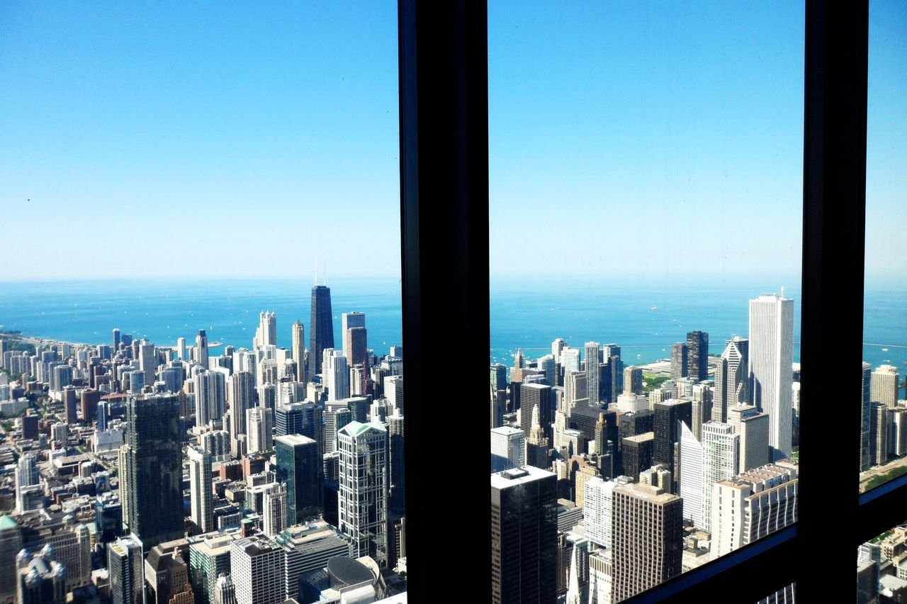 Chicago through window!!! Architecture Capital Cities  Chicago Chicago Architecture City City Life Cityscape Downtown Chicago I Love My City Modern Office Building Residential District Skyline Skyscraper Tall Tall - High Top Perspective Tower
