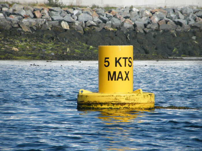 Beauty In Nature Bouy Bouy In Sea Day Nature No People Outdoors Speed Speed Limit Speed Limit 5 Speed Limit Sign Text Water Yellow