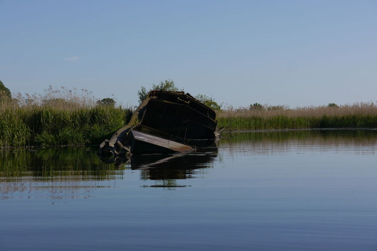 Abandoned Antic Ship Beauty In Nature Clear Sky Day Desolate Lake Nature Nautical Vessel No People Oderbruch Outdoors Polen Reflection Sunken Sunken Ship Tranquility Transportation Water Waterfront