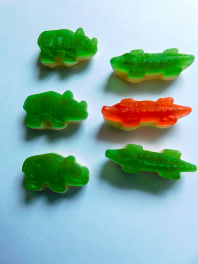 Gummy Gummy Candy Red Rino Close-up Crocodile Day Food Freshness Gelatin Dessert Green Color Gummy Bears Indoors  Multi Colored No People Still Life Studio Shot White Background