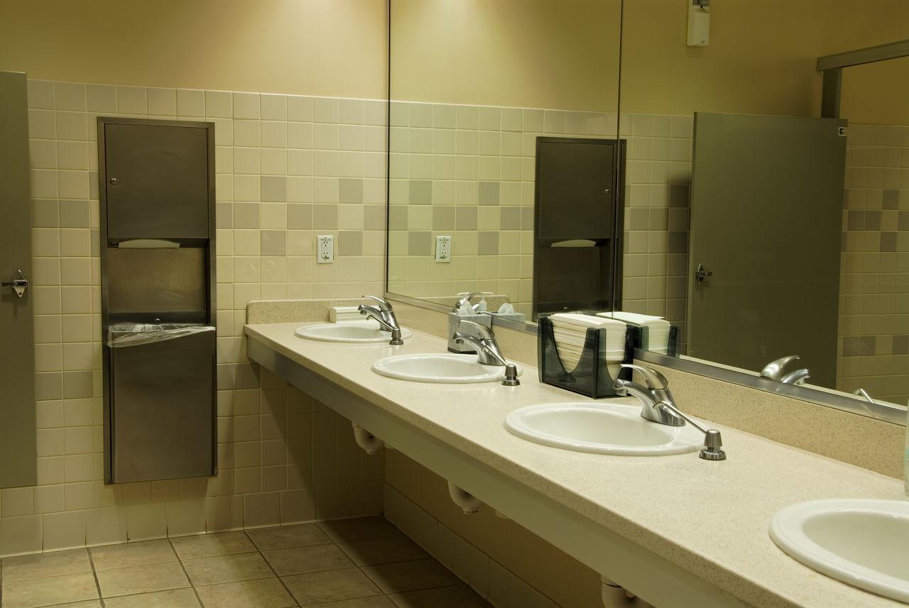 Commercial restroom. Restroom Bathroom Commercial Restroom Business Restroom Mirror Sinks Faucets Paper Towels Garbage Can Garbage Bin Tile Tiles Tiled Floor Tiled Wall Soap Dispenser Wastebasket Tissue Tissue Box