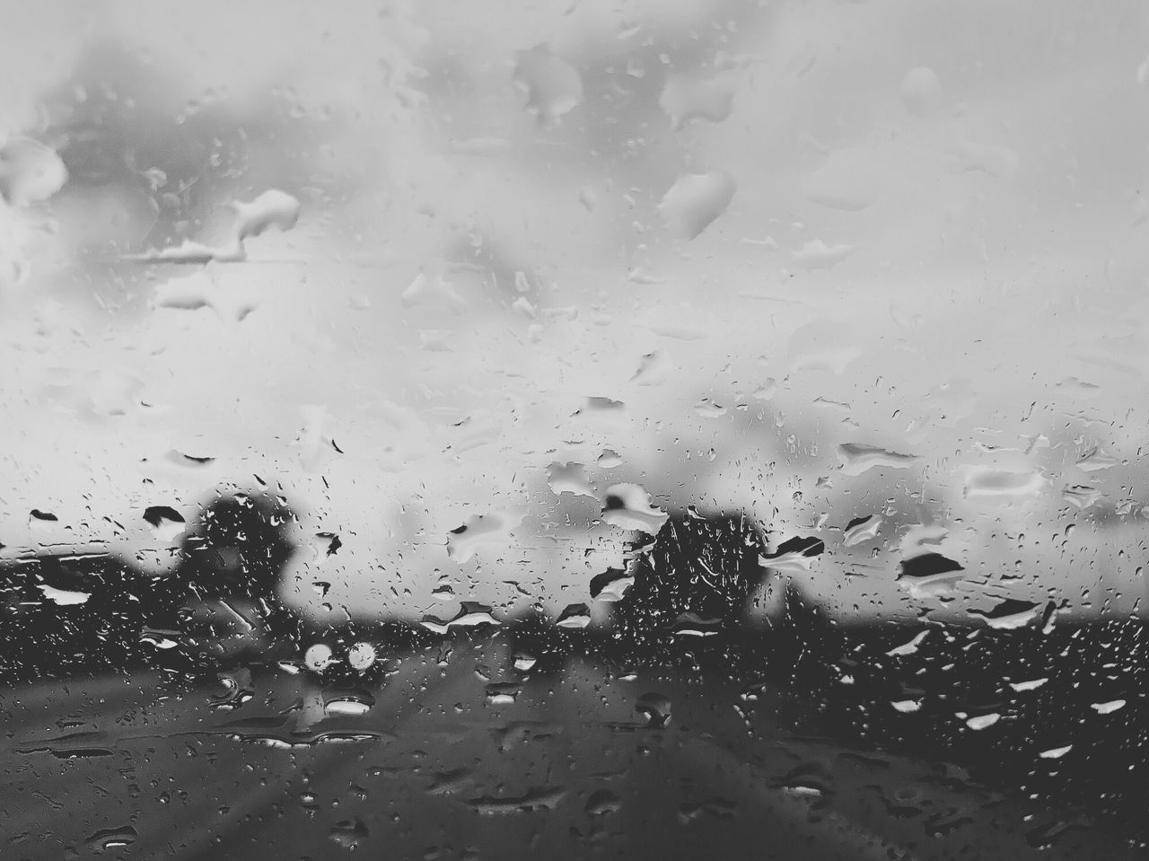 transparent, drop, glass - material, wet, window, rain, rainy season, raindrop, weather, water, backgrounds, no people, full frame, indoors, transportation, car, land vehicle, day, looking through window, car interior, close-up, nature, sky, freshness, airplane wing