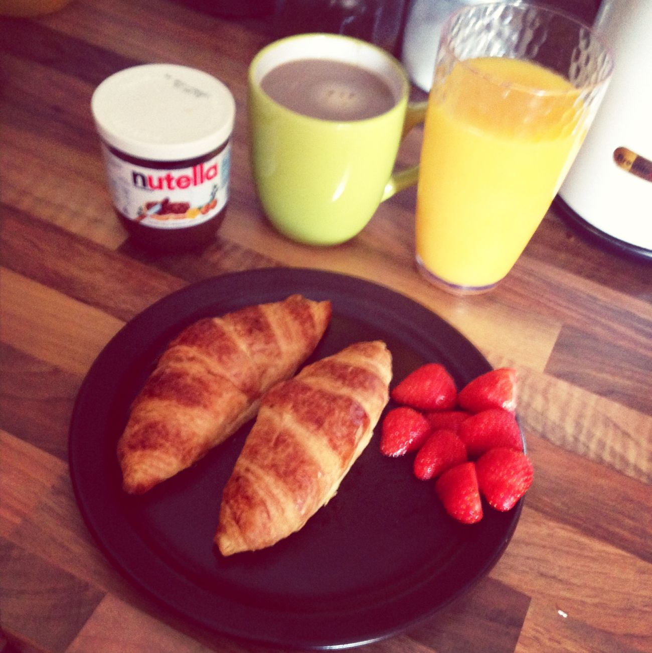 Breakfast is the most important part of the day! Croissant Nutella Fresh Orange Juice Coffee
