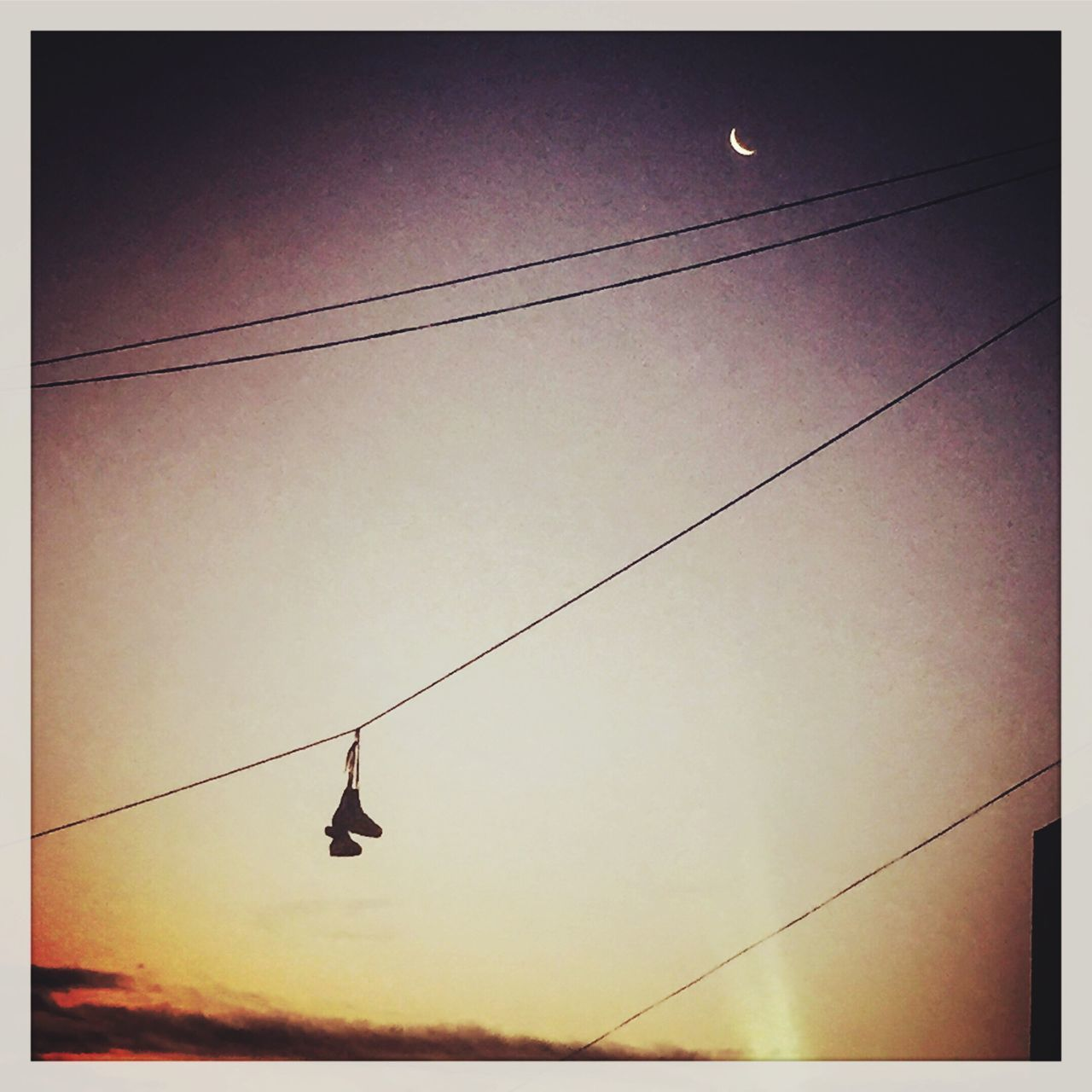 hanging, rope, cable, real people, silhouette, one person, sunset, outdoors, nature, sky, clear sky, low angle view, full length, day, extreme sports, beauty in nature, people