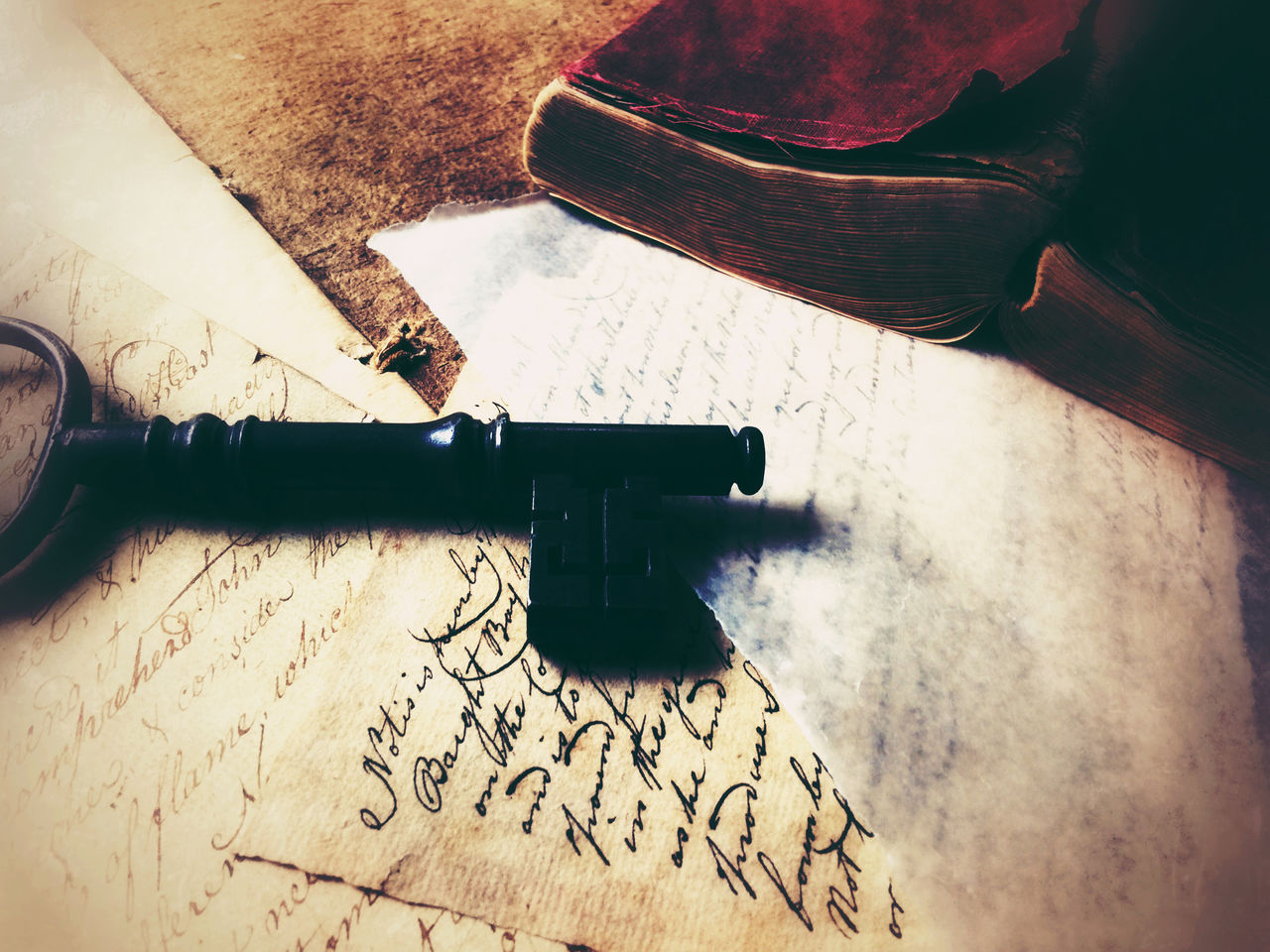 Vintage book with key and handwritten documents Atmospheric Mood Close-up Communication Copy Space Filtered Image Indoors  Key Leather Letters Nostalgic  Old Old Documents Old Handwriting Old-fashioned Pages Paper Phone Camera Romantic Still Life Text Textures Vintage Book Words