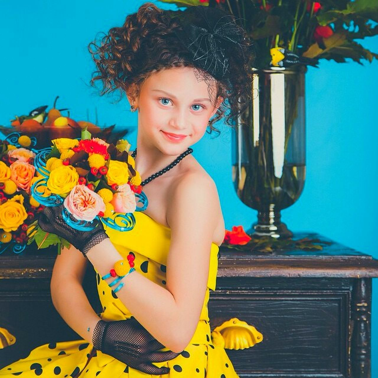 looking at camera, portrait, flower, one person, smiling, childhood, child, yellow, happiness, people, young adult, indoors, children only, cheerful, beauty, beautiful woman, young women, day, close-up, adult