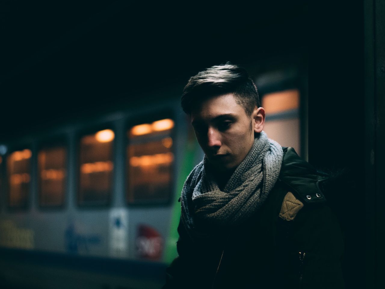 Only Men Handsome One Man Only One Person Casual Clothing Fashion Portrait Lifestyles One Young Man Only Hipster - Person Young Adult Adults Only Beard Night Confidence  Men Illuminated Standing Warm Clothing People Train Station Night Lights City Urban