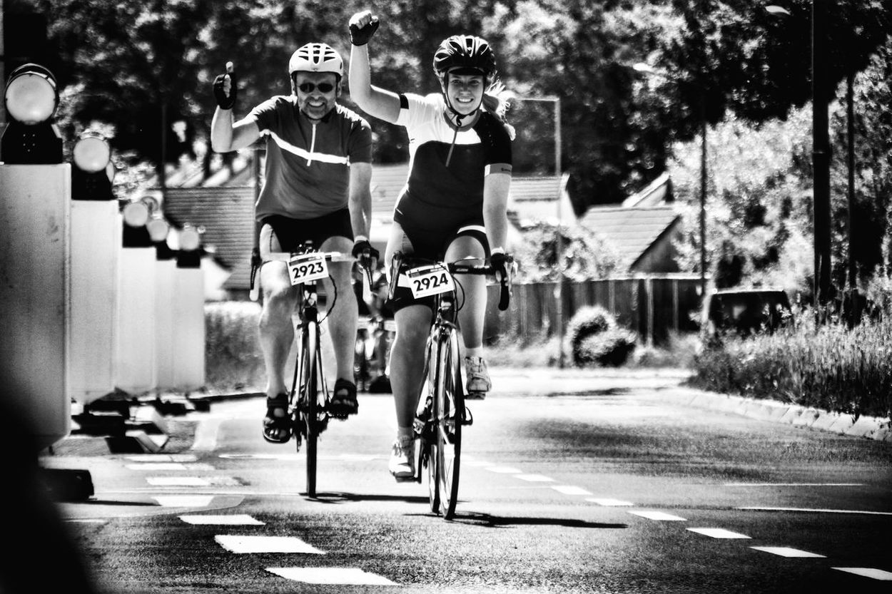 Cycle Race Cycle Racing Racing Bicycle Finish Cycling Sports Race Sport Speed Road Athlete Man Woman Father And Daughter Gritty Woman Competition Sports Clothing Happiness Pleasure Black And White Streetphotography Day Outdoors Fürth The Street Photographer - 2017 EyeEm Awards
