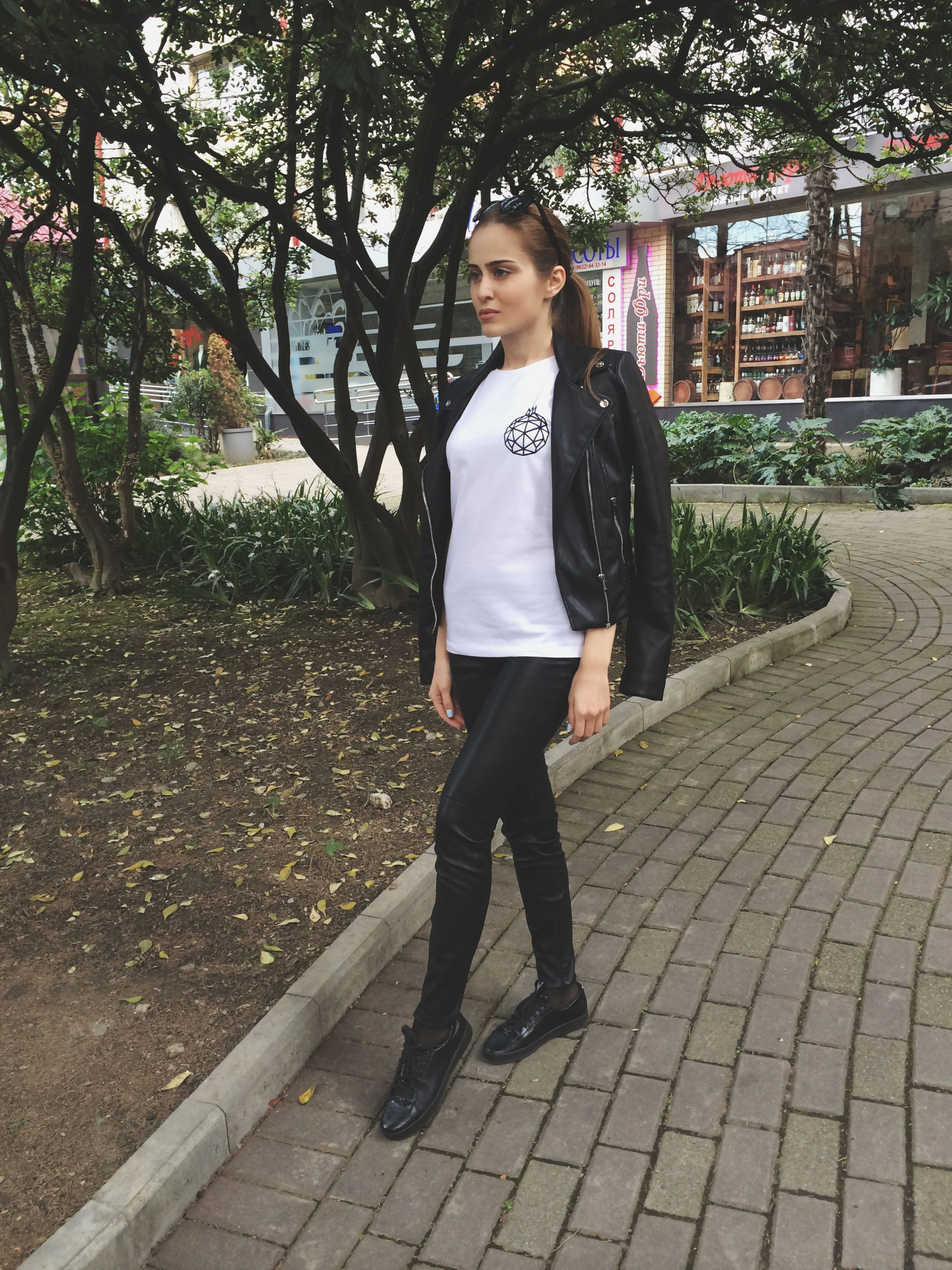 young adult, person, looking at camera, portrait, casual clothing, lifestyles, full length, front view, young women, leisure activity, standing, smiling, happiness, street, fashion, tree, outdoors