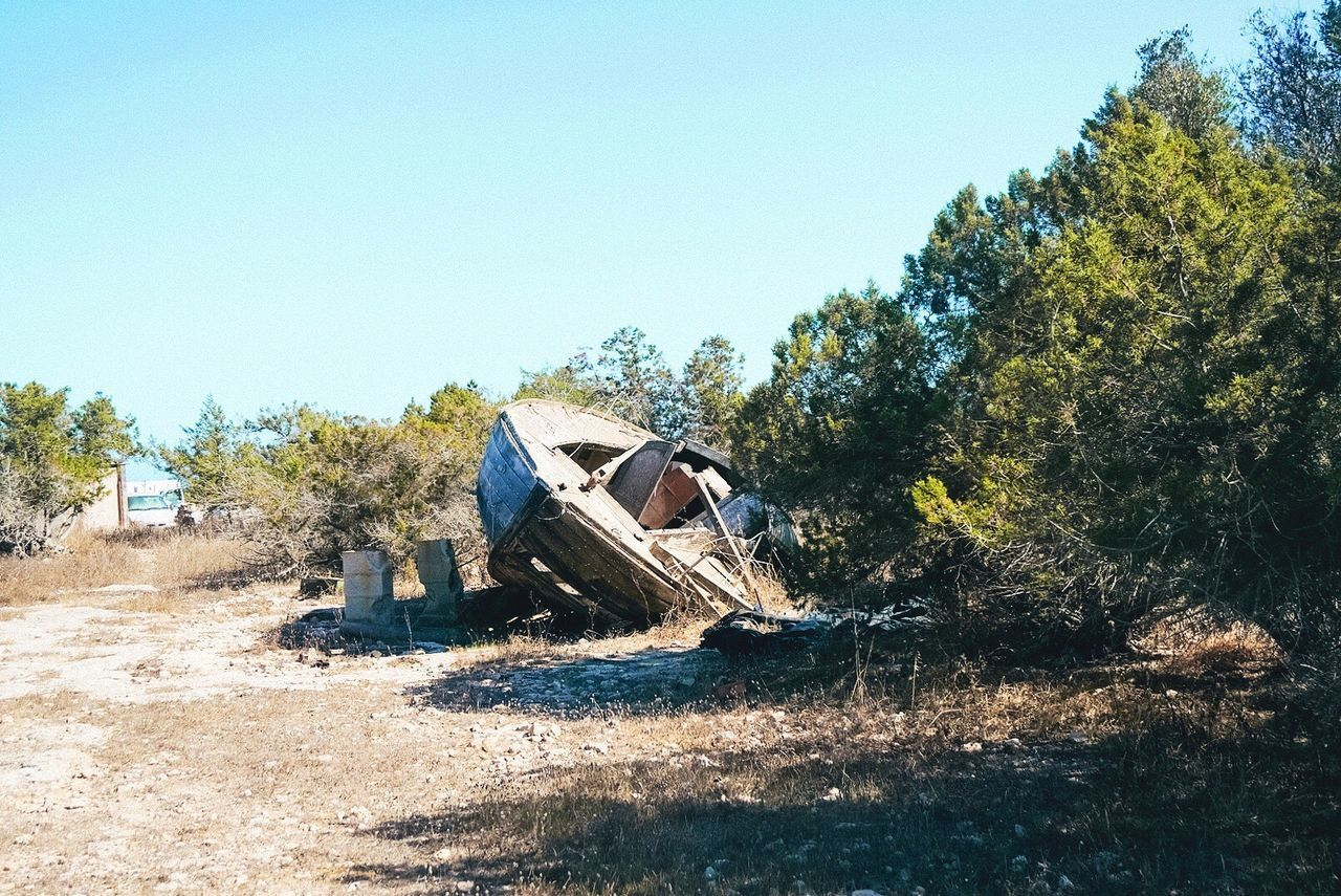 Clear Sky Abandoned Day No People Copy Space Damaged Tree Machinery Outdoors Destruction Sky Rubble Nature Destroyed Boat Boat Destroyed Alone Old Boat Old