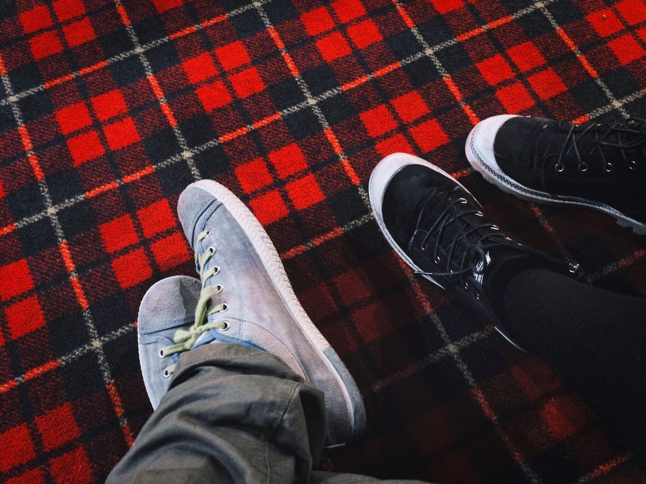 Personal perspective on our sneakers Shoes Sneakers Tennis Shoes Personal Perspective Perspective View From Above Carpet Red And Black Black And White Legs Sitting Two People Chilling Close-up Backgrounds Lumberjack Pattern Square Pattern Sneaker Shoes Fashion Style