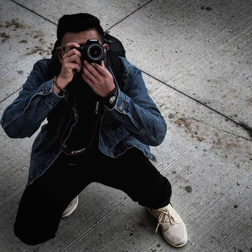 Adult Adults Only Camera Camera - Photographic Equipment Day Digital Camera Digital Single-lens Reflex Camera Holding Leisure Activity Lifestyles Men One Man Only One Person Only Men Outdoors People Photographer Photographing Photography Themes Portrait Real People SLR Camera Standing Technology Young Adult