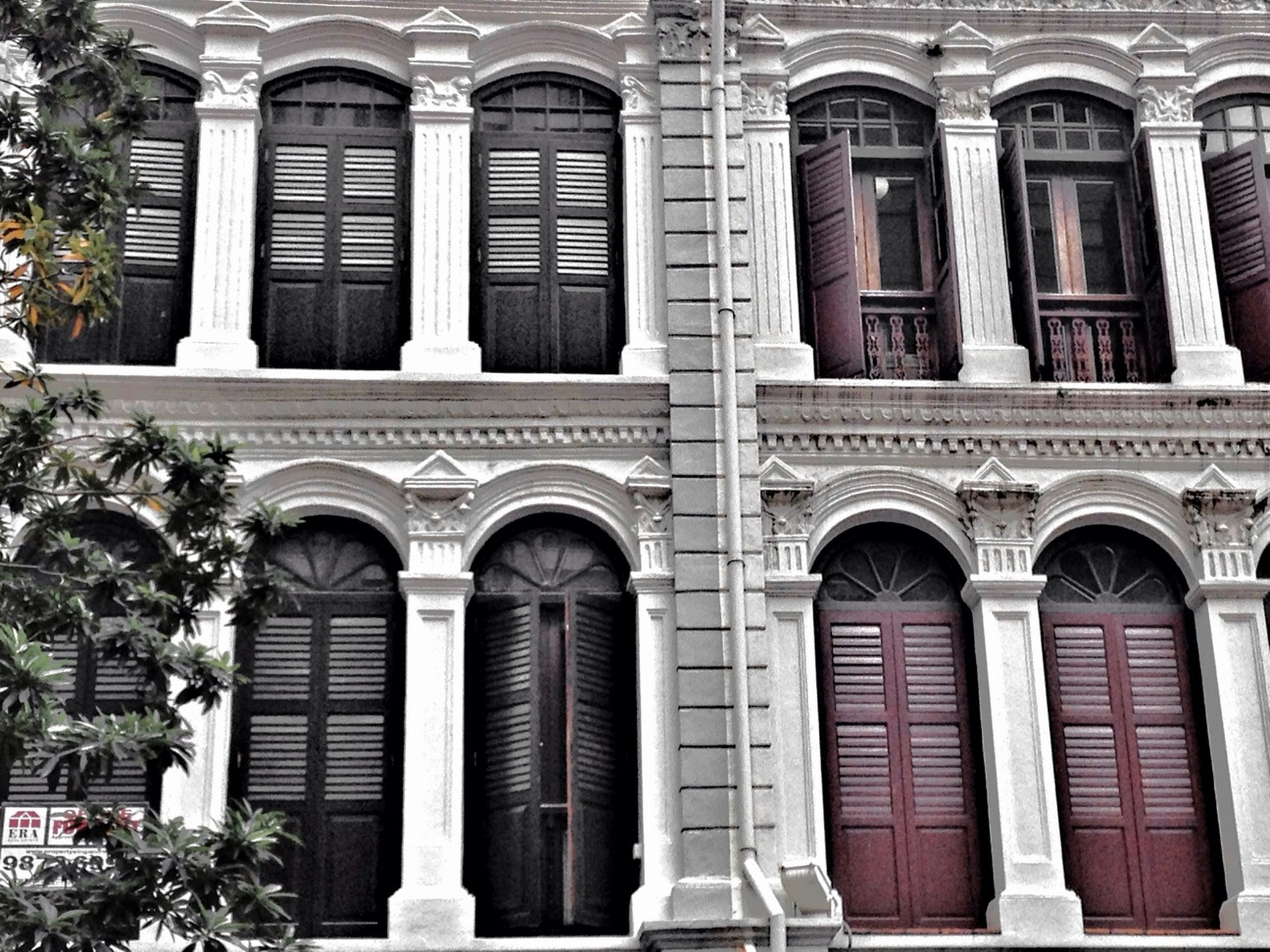 architecture, building exterior, built structure, window, arch, low angle view, facade, building, outdoors, day, old, residential building, balcony, no people, architectural column, door, entrance, in a row, history, repetition