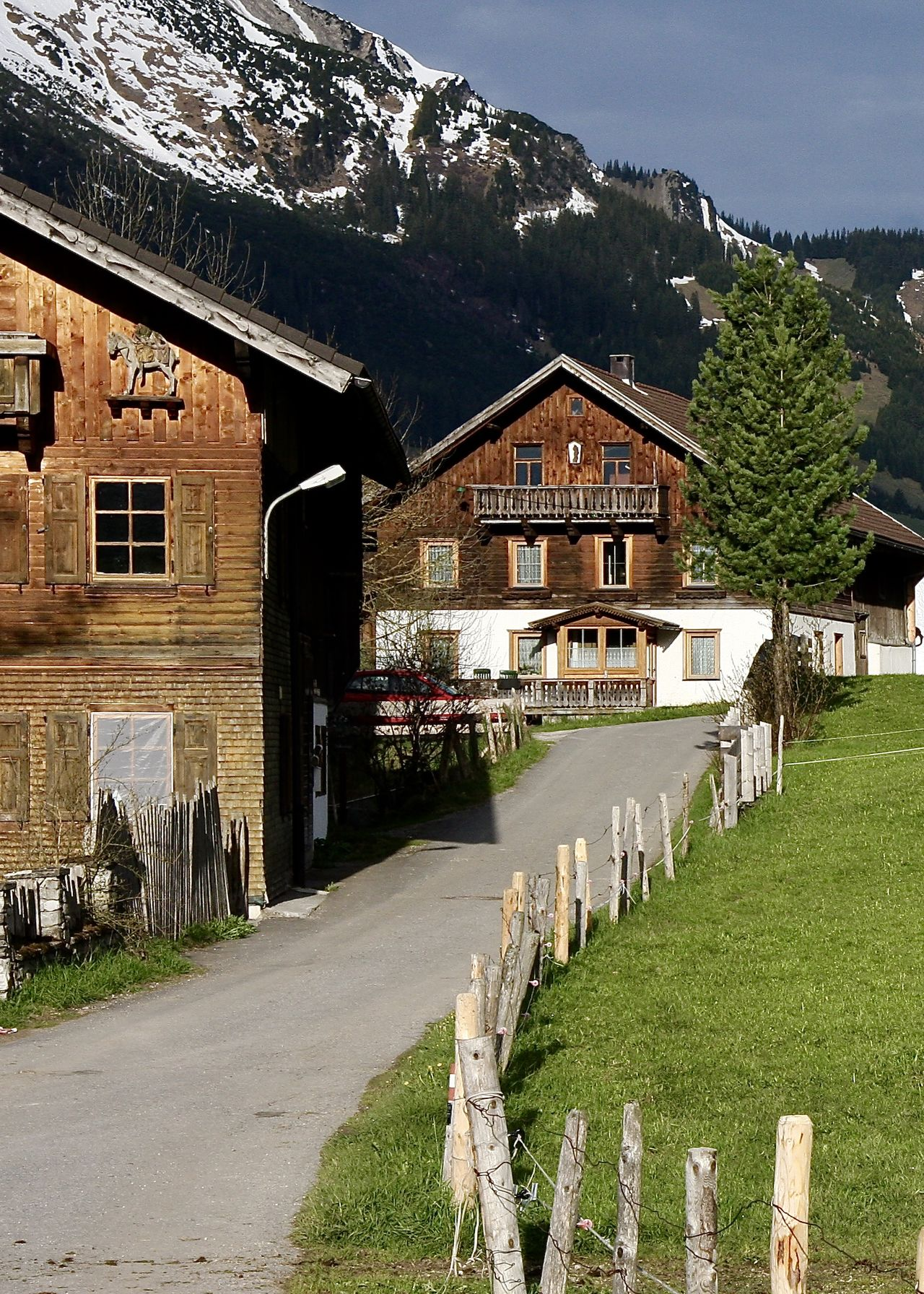 Alps Architecture Building Exterior Built Structure Colors Fence Grass Growth Holiday House Light Mountain Nature Outdoors Road Sky Snowcapped Mountain Spring Tannheimer Tal The Way Forward Tirol  Traditional Travel Tree Village