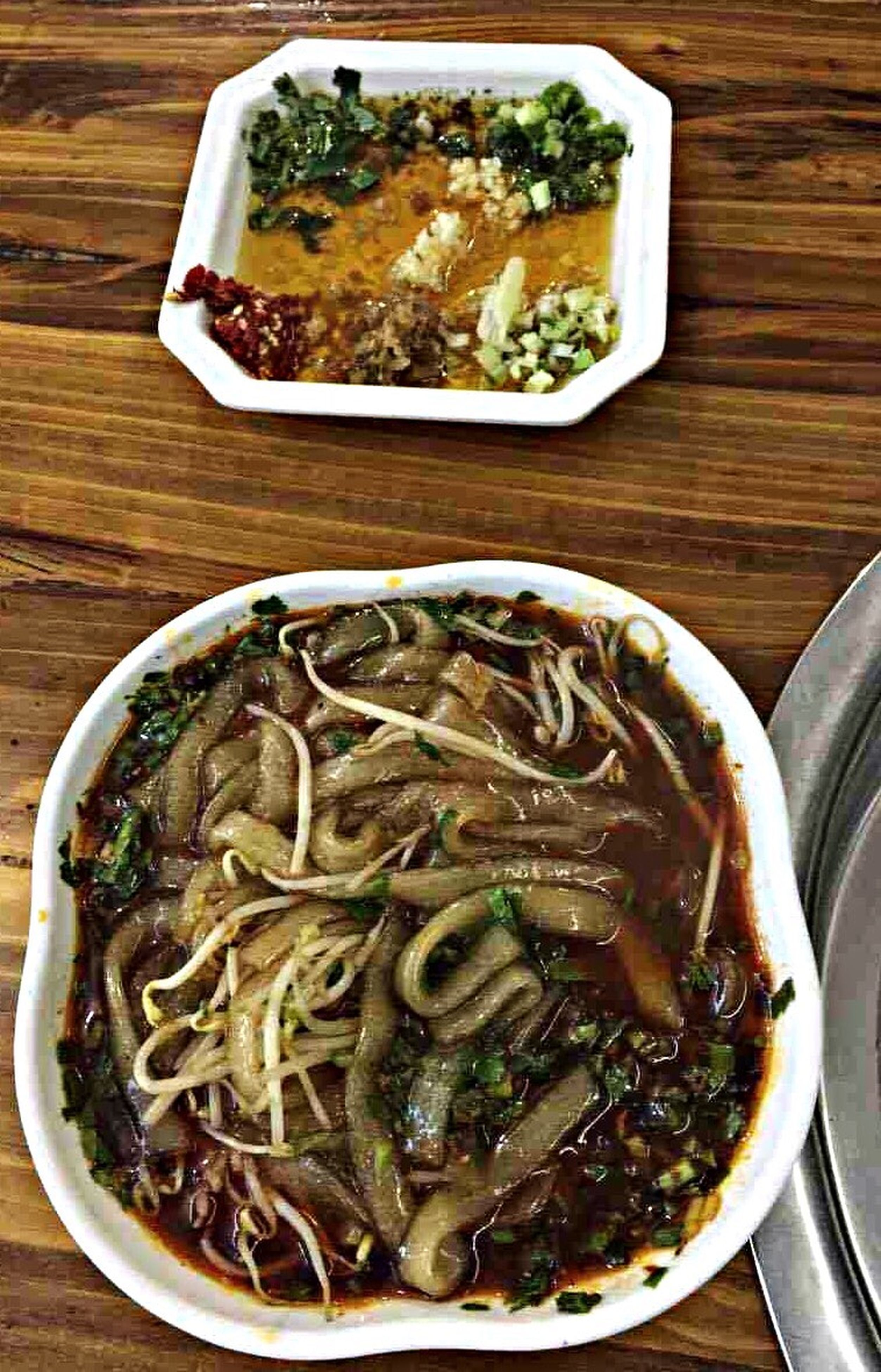 food and drink, indoors, food, freshness, ready-to-eat, table, healthy eating, still life, high angle view, bowl, plate, serving size, meal, noodles, close-up, directly above, spoon, indulgence, meat, no people