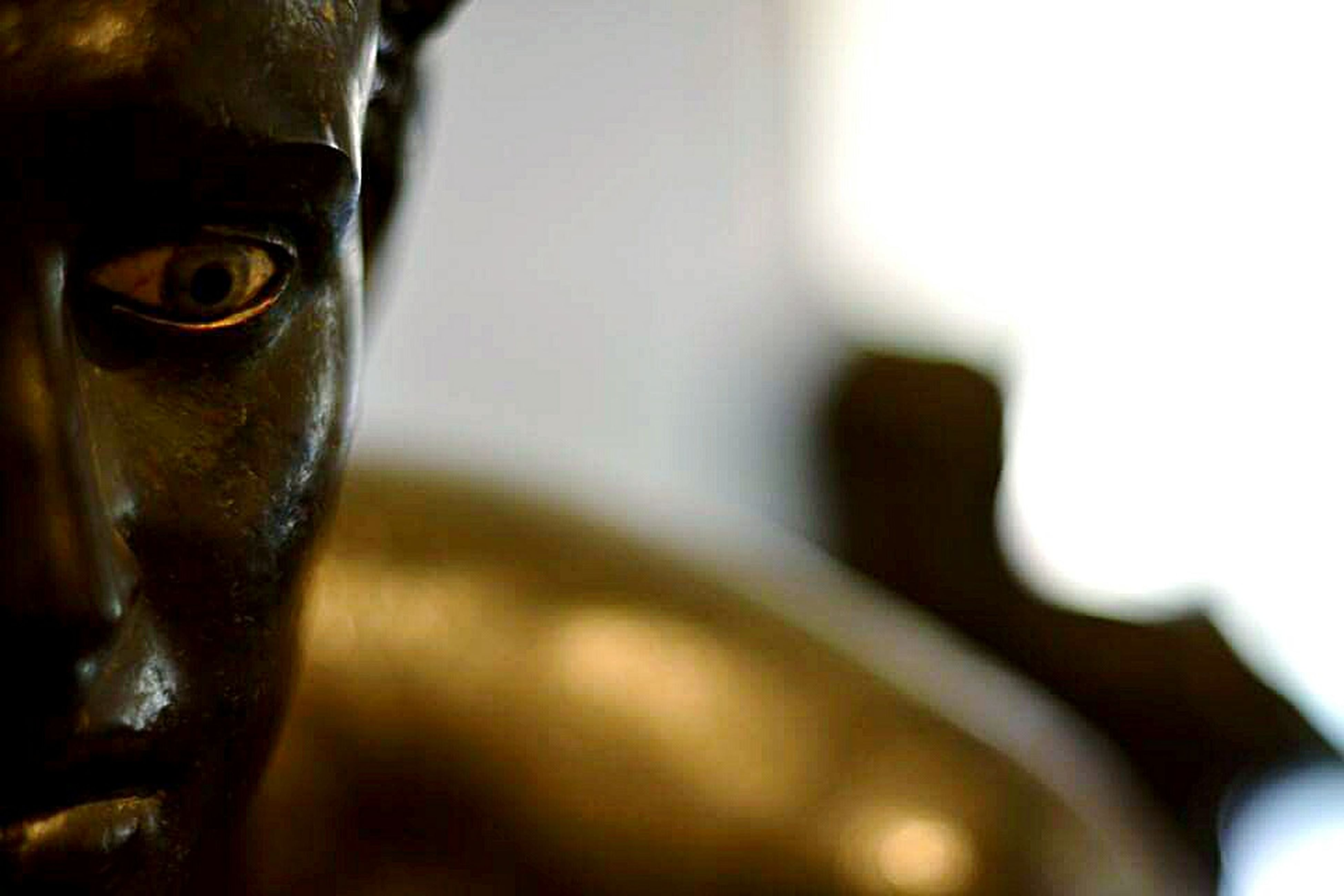 close-up, indoors, focus on foreground, selective focus, art and craft, part of, sculpture, statue, metal, human representation, art, no people, creativity, day, old, cropped, wall - building feature, single object, detail