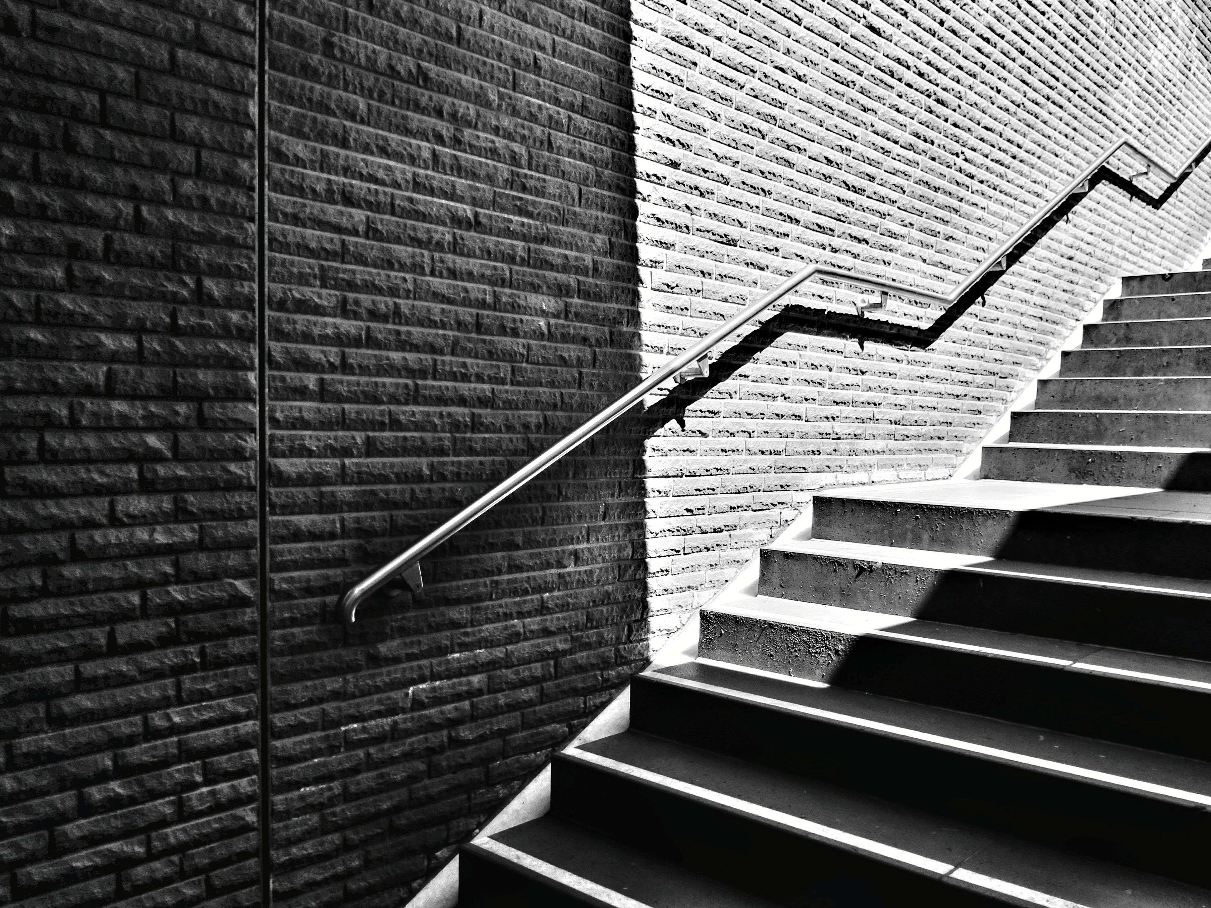 architecture, building exterior, built structure, low angle view, brick wall, building, steps and staircases, steps, pattern, staircase, city, wall - building feature, day, no people, window, outdoors, residential structure, modern, residential building, architectural feature