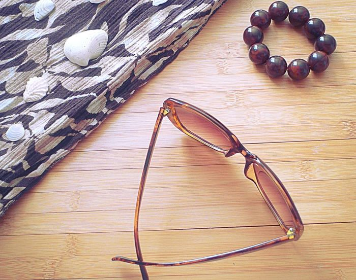 Accessories Arrangement Beach Accessories Bracelet Bridge Brown Close-up No People Selfie Shells Still Life Sunglasses Table Tan Water Wood - Material Wooden summer