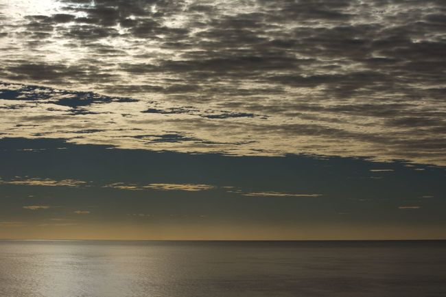 Beauty In Nature Cloud Cloud - Sky Cloudy Horizon Over Water Idyllic Nature No People Non-urban Scene Orange Color Outdoors Overcast Remote Rippled Scenics Sea Seascape Sky Sun Sunset Tranquil Scene Tranquility Water Waterfront Weather