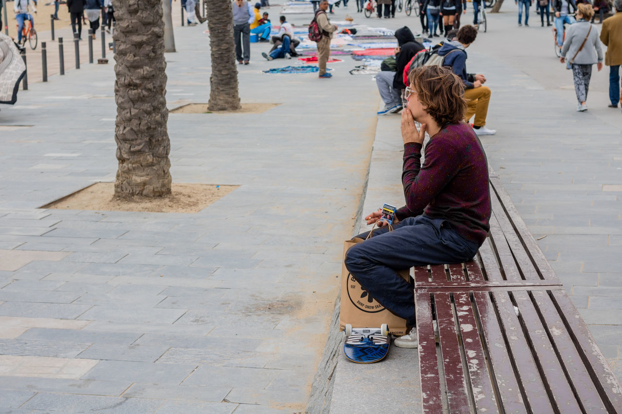 Lifestyles Leisure Activity Sitting Outdoors Real People Full Length One Person People Adult Day Women Adults Only Human Body Part One Woman Only Only Women Young Adult Human Hand Film Photography Portrait Of A City Barcelona Beach Skater Port Vell Shootermag