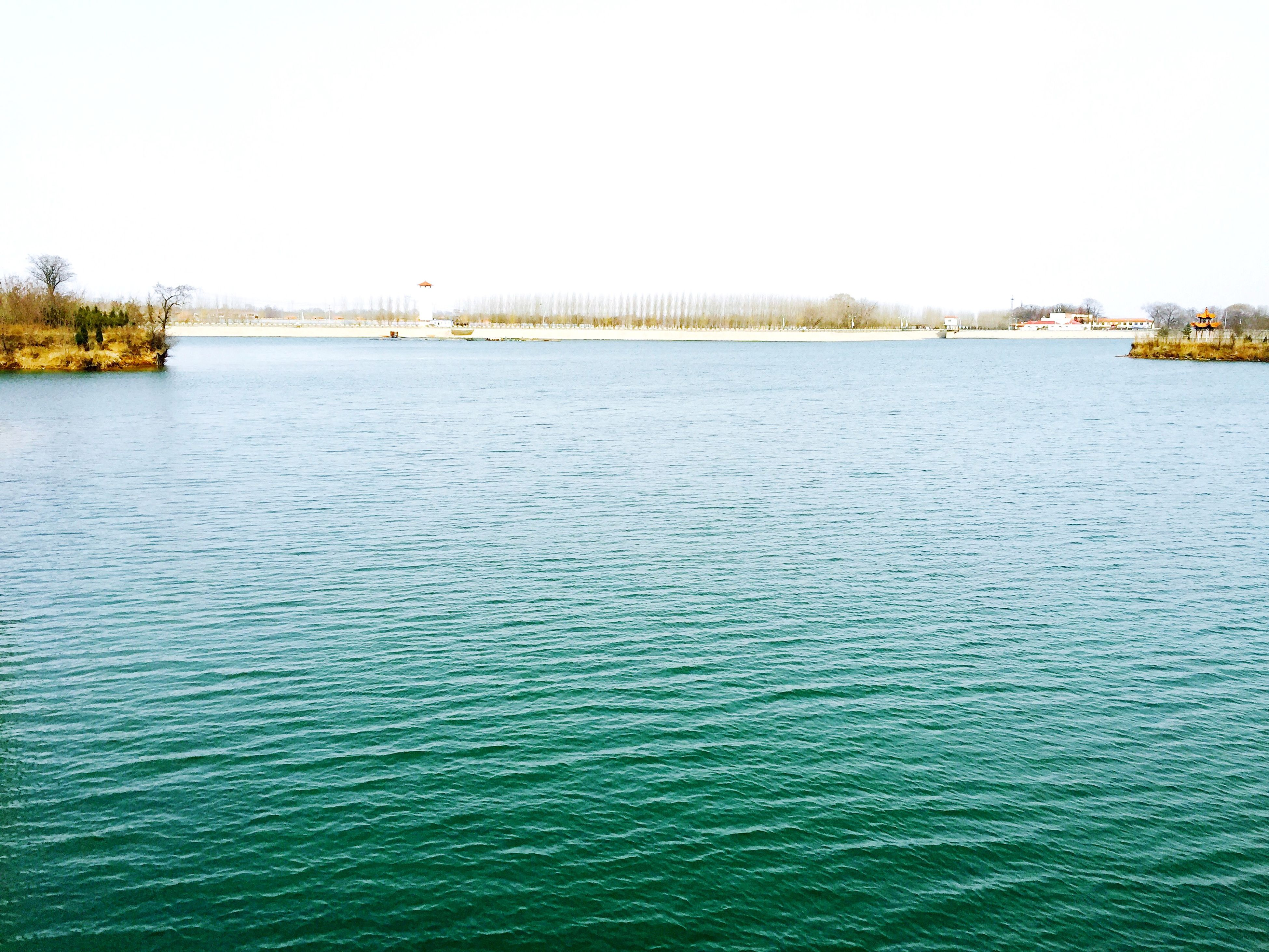water, waterfront, clear sky, rippled, copy space, tranquil scene, tranquility, scenics, beauty in nature, blue, nature, sea, tree, idyllic, lake, day, outdoors, no people, river, calm