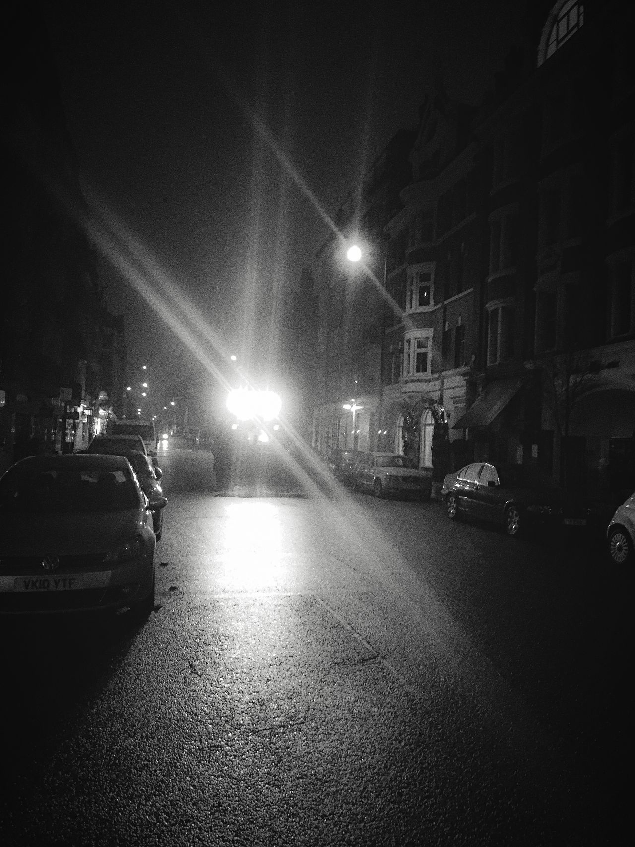 Street Photography Big Tractor Speeding Central London Street Light Illuminated Dark Street City EyeEm Best Shots Street Light Cold Temperature Vanishing Point 4am Blackandwhite EyeEm Best Shots - The Streets The Week Of Eyeem Fresh On Eyeem  Urban Exploration Streetphotography Headlights Night Architecture Residential District Misty