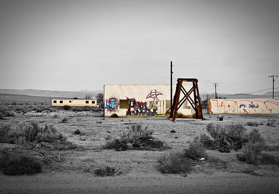 """""""Barstow City Limits"""" Urban decay and graffiti artists have claimed these abandoned buildings on the fringes of the desert city limits of Barstow, California, USA. Urbandecay Abandoned Buildings Abandoned & Derelict Graffiti Black And White Photography Blackandwhite Photography Blackandwhite Black And White Selective Color Barstow Desert"""