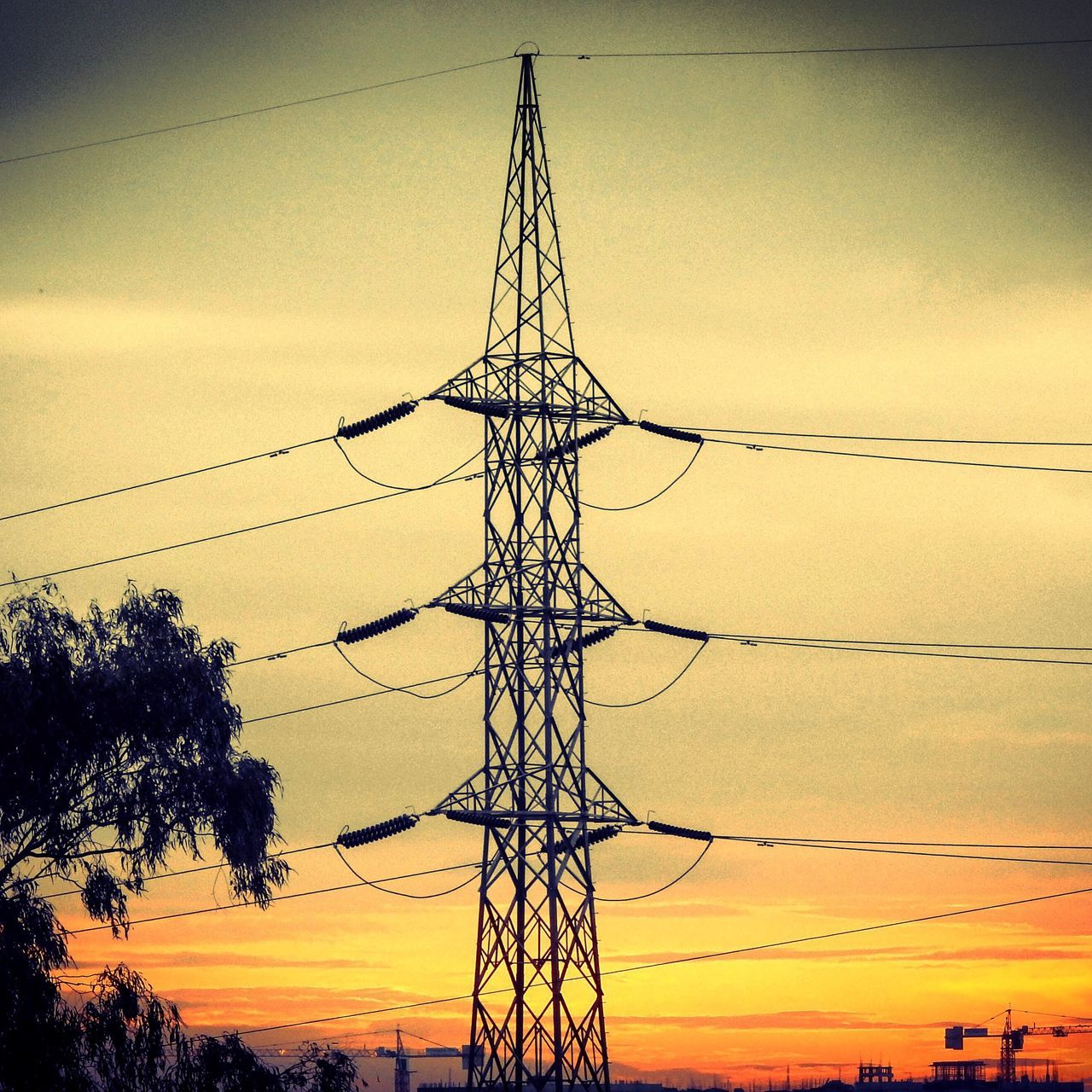 Silhouette Electricity Pylon Against Sky At Sunset